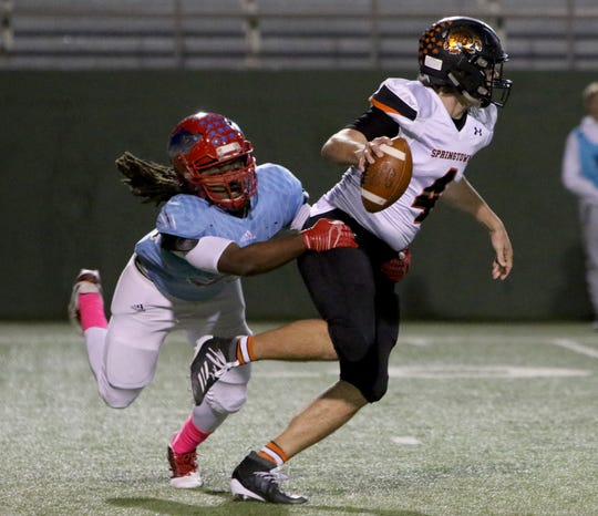 Springtown's Camden Chesney escapes the sack from Hirschi's Cameron Whitehead Thursday, Oct. 31, 2019, at Memorial Stadium.
