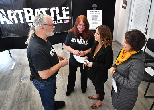 Art Battle Wichita Falls organizer Bob Barrow, WF Art Association president Kim Ward, Jana Schmader, executive director of Downtown Wichita Falls Development and Jesse Baggett, winning artist of the June Art Battle, talk following the announcement that the 2020 Art Battle National Championship will be in Wichita Falls in April.