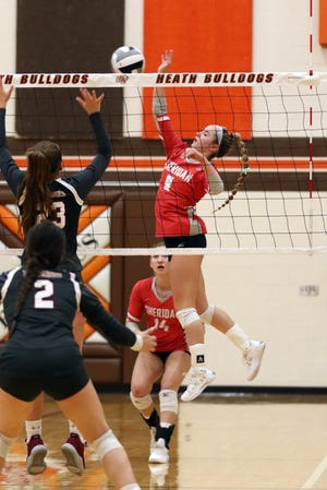 Sheridan's Brooklyn Heller hits the ball against Dover.