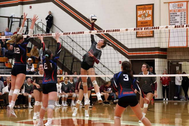 John Glenn's Abigail Walker hits the ball against Highland in the regional semifinal. Walker was the District 12 Division II player of the year.