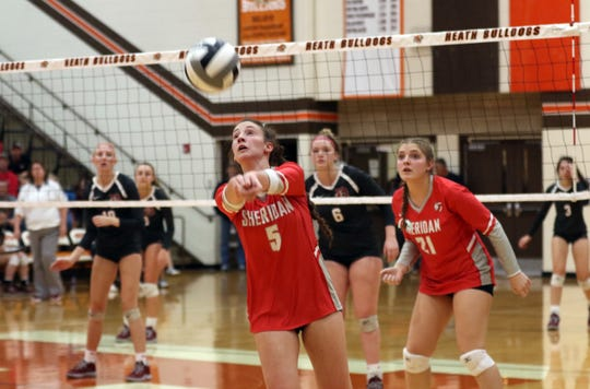 Sheridan's Grace Conrad hits the ball against Dover. Conrad was named the league's offensive player of the year.