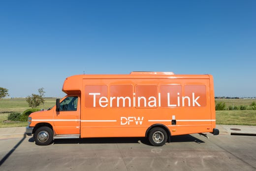 """<strong>Getting around DFW &ndash; Pre-security </strong><br /> <strong>Courtesy shuttles:</strong> In addition to walking between terminals and taking the free post-security Skylink light rail train between terminals, passengers can get around DFW by the <a href=""""https://www.dfwairport.com/connect/index.php"""" target=""""_blank"""">DFW Terminal Link </a>outside security.<br /> <br /> These free orange vans travel between all terminals every 10 minutes. Follow the Terminal Link signs for pick-up and drop-off points.<br /> <br /> <strong>Hours:</strong> 5 a.m. to 12:00 a.m. CT.<br /> <br /> <strong>After-hours pick up is available:</strong> Call 972.574.LINK (5465)"""