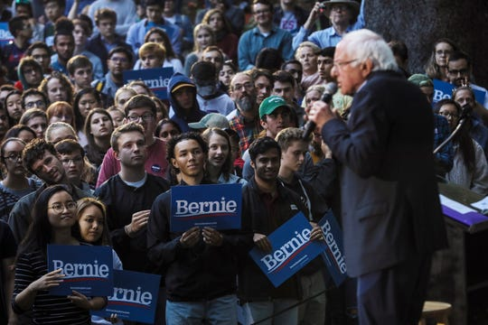 Students listen as Democratic presidential candidate Sen. Bernie Sanders, I-Vt., speaks campaign event Sunday, Sept. 29, 2019, at Dartmouth College in Hanover, N.H. (AP Photo/Cheryl Senter)