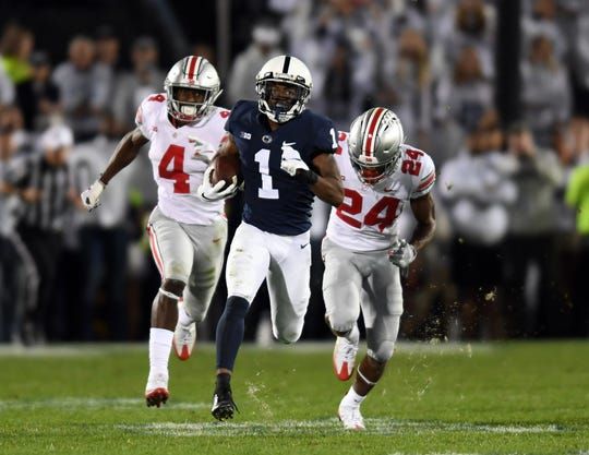 Penn State wide receiver KJ Hamler breaks free from the Ohio State defense to score a touchdown during their game in 2018 at Beaver Stadium.