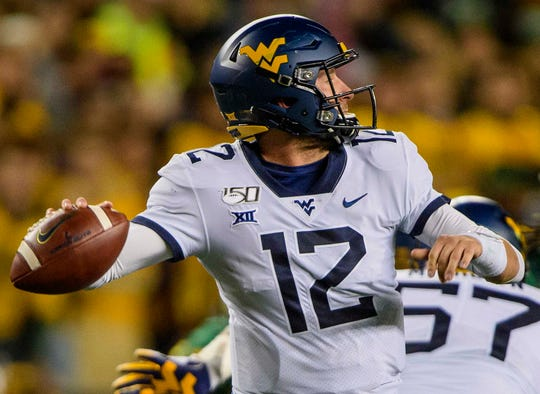 West Virginia quarterback Austin Kendall passes against Baylor during the first quarter at McLane Stadium.