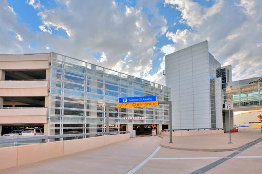 """<strong>Parking at DFW </strong><br /> <a href=""""https://www.dfwairport.com/parking/index.php"""" target=""""_blank"""">DFW's parking options</a> include Valet service (all terminals), Terminal garages, Express and Remote.<br /> <br /> <strong>Prepaid parking:</strong>&nbsp;<a href=""""https://www.dfwairport.com/parking/tolltag/index.php"""">Toll-tags</a>, reservations and <a href=""""https://onlineparking.dfwairport.com/en/"""">discounts for pre-paid parking</a>&nbsp;are all available.<br /> <br /> <strong>Valet:</strong> <a href=""""https://www.dfwairport.com/cs/groups/webcontent/documents/webasset/p1_062737.pdf"""">Car wash/detail services</a> available. Car pick-up in one-hour terminal parking area.<br /> <br /> <strong>Cell phone lots:</strong> These free lots are located at both the north and south ends of the airport. Drivers may stay there for two hours only. The north lot, located before the&nbsp;North Toll Plaza, has 53 spaces. The south lot has 64 spaces and is located&nbsp;east of the South Shell station, across from post office."""