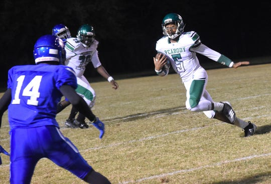 Peabody junior Tyriq Miles (5) dashes for yards against Bolton in a conference game Friday, Nov. 1, 2019. Peabody won 20-6.