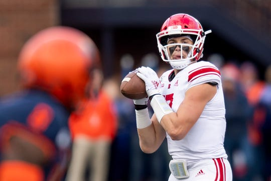 Nov 2, 2019; Champaign, IL, USA; Rutgers Scarlet Knights quarterback Johnny Langan (17) drops back to pass against the Illinois Fighting Illini during the first half at Memorial Stadium. Mandatory Credit: Patrick Gorski-USA TODAY Sports