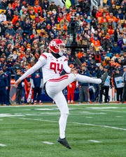 Nov 2, 2019; Champaign, IL, USA; Rutgers Scarlet Knights punter Adam Korsak (94) punts the ball during the first half against the Illinois Fighting Illini at Memorial Stadium. Mandatory Credit: Patrick Gorski-USA TODAY Sports