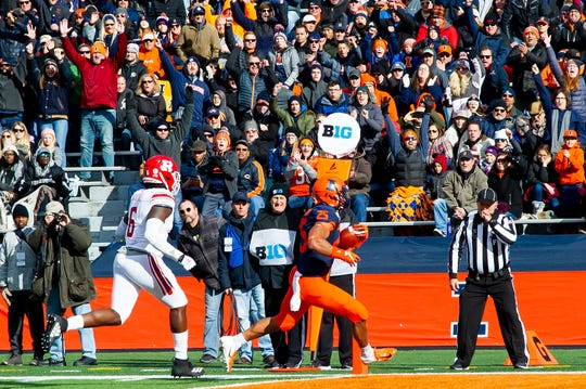 Nov 2, 2019; Champaign, IL, USA; Illinois Fighting Illini running back Dre Brown (25) runs in for a touchdown against the Rutgers Scarlet Knights during the first half at Memorial Stadium. Mandatory Credit: Patrick Gorski-USA TODAY Sports