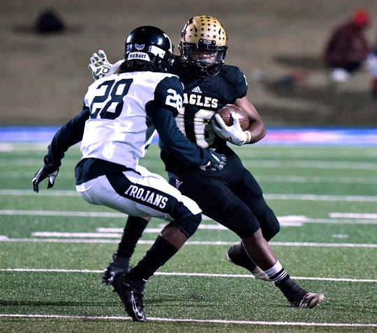 Euless Trinity defensive back Cameron Andrews confronts Abilene High running back Davonta Mayse during Friday's game at Shotwell Stadium Nov. 1, 2019. Final score was 42-21, Euless Trinity.
