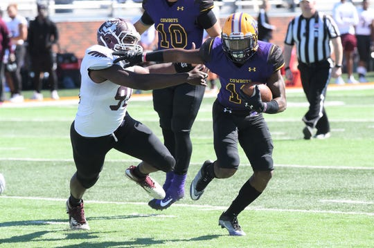 Hardin-Simmons running back Jaquan Hemphill (16) shakes a McMurry tackle at Shelton Stadium on Saturday. Hemphill broke the Cowboys' career touchdown record with his first score of the game.