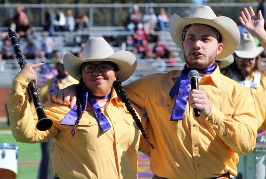"Jared Grover, who plays trumpet in the Hardin-Simmons University Band, sings ""Little Liza Jane"" with Alyssa Castillo, a clarinetist, during halftime of Saturday's HSU vs. McMurry game at Shelton Stadium."
