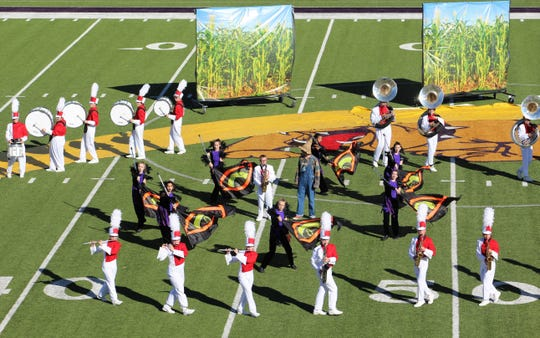 The Clyde High School marching band adds a yellow brick road, cornfields and scarecrow to its UIL show that has qualified for the state contest this week in San Antonio.