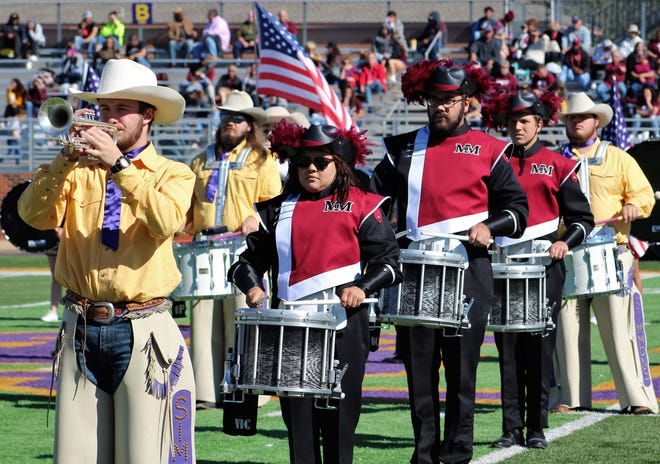 Members of the Hardin-Simmons' Cowboy Band and McMurry's Marching Band combined Saturday afternoon at HSU's Shelton Stadium to perform the Armed Forces Salute, a medley of service songs, backed by an array of U.S. flags. While the musicians were balanced on the field, the crosstown football game was not, with HSU winning 91-29.