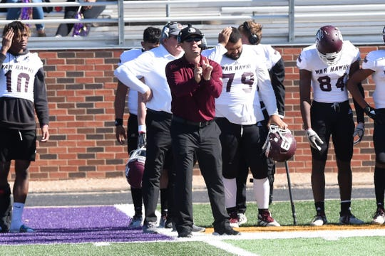 McMurry head coach Jordan Neal signals in a play against Hardin-Simmons at Shelton Stadium.