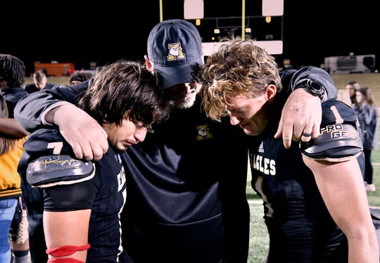 Abilene High Head Coach Mike Fullen consoles linebacker Ryan Cruz (left) and defensive back Colton Wilson after Friday's loss to Euless Trinity Nov. 1, 2019. This was the last game of the season, final score was 42-21, Euless Trinity.