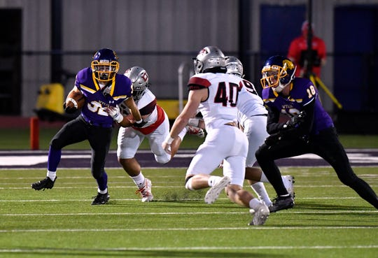 Wylie High running back Noah Beach tries to outpace the Lubbock Cooper defense during Friday's game at Bulldog Stadium. Lubbock Cooper won, 49-14.