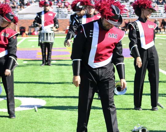 "McMurry University musicians get in a zombie mood to mimic dancers in the famous Michael Jackson video for his hit ""Thriller"" during their halftime performance Saturday at Hardin-Simmons' Shelton Stadium."