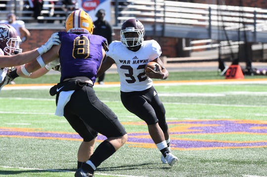 McMurry running back Dee Robinson (32) carries the ball against Hardin-Simmons at Shelton Stadium on Saturday.