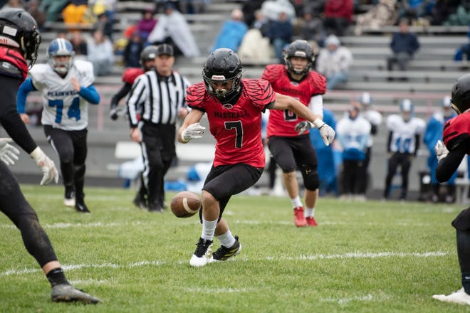 Marshall wide receiver Ezra McAllister (7) recovers the ball on Saturday, Nov. 2, 2019 at Marshall High School in Marshall, Mich.