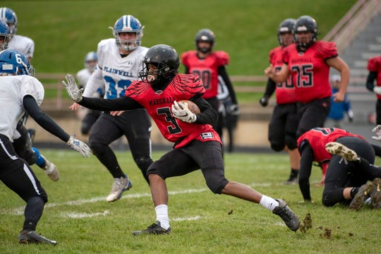 Marshall running back Thailan Taylor (3) pushes the ball past Plainwell defenseman Justin LaGrow (6) on Saturday, Nov. 2, 2019 at Marshall High School in Marshall, Mich. Marshall defeated Plainwell 43-6 and advances to the district finals.