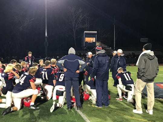 Chenango Forks coaches and players gather after their 48-17 Section 4 Class B semifinal victory over visiting Norwich on Friday.