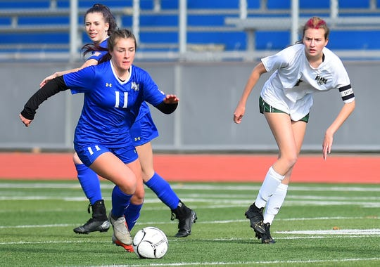 Maine-Endwell's Kaety L'Amoreaux controls the ball during Saturday's Section 4 Class A final against visiting Vestal.