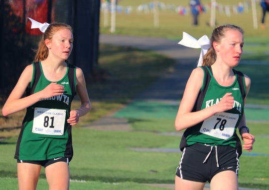 Chambers Bay hosted the district championship cross country meet on Nov. 2, 2019. Klahowya's Alyssa Becker (right) and Rachel Newhard placed first and second in the girls 1A race and helped the Eagles win a team title.