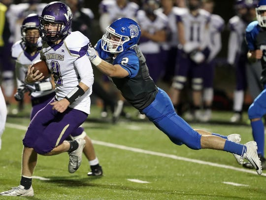 Olympic's Taylor Andrews (2) brings down North Kitsap's Colton Bower (2) during the first half of their game on Friday, November 1, 2019.