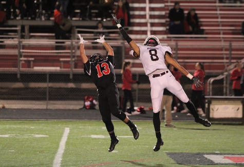 Owen senior Fred Graves leaps as he attempted to haul in a pass during the Warhorses' Nov. 1 win over Avery.