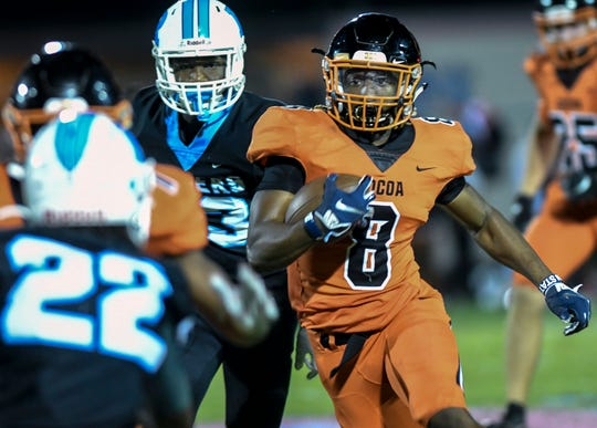 Caziah Holmes of Cocoa runs the ball during Friday's game against Rockledge