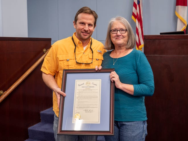 Legislative aide Christine Furru was recognized with a resolution upon her retirement by County Commissioner  John Tobia, whom she worked for in his County Commission and Florida House of Representatives offices.