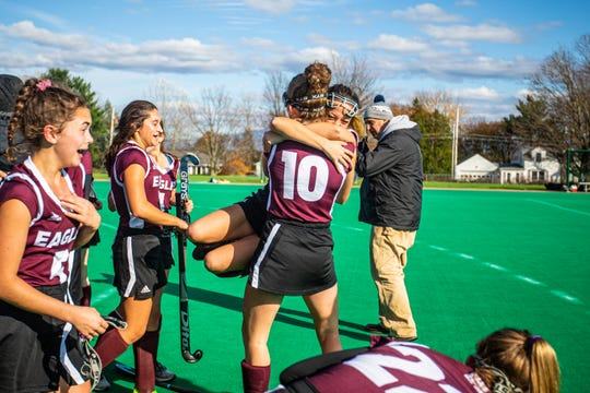 Mt. Abraham's Ava Konczal (10) hoists up her teammate in celebration after winning the Division II field hockey championship against Otter Valley Union High School at UVM's Moulton Winder Field on Saturday November 2 2019.