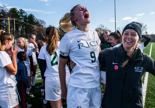 Rice Head Coach Aubrey Ouellet and Alex Dostie celebrate after winning the Div. 2 girls soccer championship against Harwood Union on Saturday, Nov. 2, 2019, at South Burlington High School. Rice won, 2-1.
