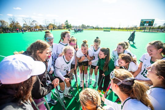Rice Memorial High School players celebrate after winning the Division I field hockey championship 4-0 over Bellows Falls Union High School at UVM's Moulton Winder Field in South Bulington on Saturday November 2 2019.