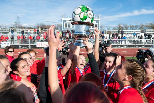CVU celebrates the championship during the DI girls soccer championship game between the Colchester Lakers and the Champlain Valley Union Redhawks at Buck Hard Field on Saturday morning November 2, 2019 in Burlington, Vermont.