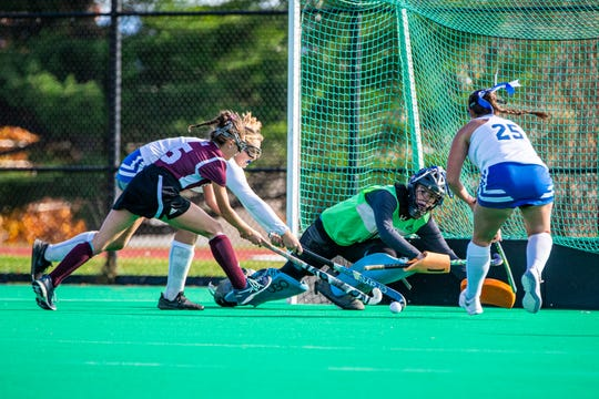 Otter Valley's goalkeeper Elinor Ross follows the ball during the Division II field hockey championship between Otter Valley Union High School and Mt Abraham Union High School at UVM's Moulton Winder Field on Saturday November 2 2019.