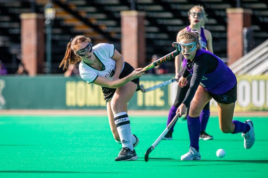 Rice's Kristen Varin sends the ball under pressure from Bellows Falls' Ariana Wunderle during the Division I field hockey championship between Rice Memorial High School and Bellows Falls Union  High School at UVM's Moulton Winder Field in South Bulington on Saturday November 2 2019.