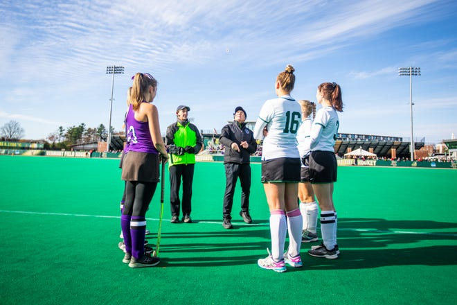 Sharon Newcomb flips the coin before the Division I field hockey championship between Rice Memorial High School and Bellows Falls Union  High School at UVM's Moulton Winder Field in South Bulington on Saturday November 2 2019.