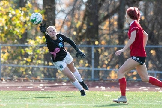 Colchester goalie Olivia Moore (19) dives to try to save the ball during the DI girls soccer championship game between the Colchester Lakers and the Champlain Valley Union Redhawks at Buck Hard Field on Saturday morning November 2, 2019 in Burlington, Vermont.