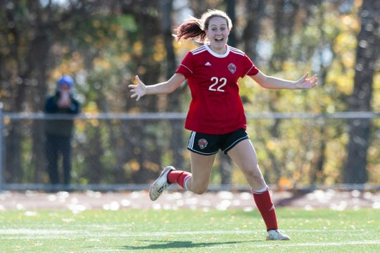 CVU's Josie Pecor (22) celebrates after scoring her second goal of the game during the DI girls soccer championship game between the Colchester Lakers and the Champlain Valley Union Redhawks at Buck Hard Field on Saturday morning November 2, 2019 in Burlington, Vermont.