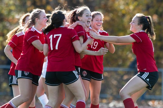 CVU celebrates a goal during the DI girls soccer championship game between the Colchester Lakers and the Champlain Valley Union Redhawks at Buck Hard Field on Saturday morning November 2, 2019 in Burlington, Vermont.