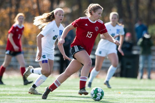 CVU's Olivia Morton (15) runs down the field with the ball during the DI girls soccer championship game between the Colchester Lakers and the Champlain Valley Union Redhawks at Buck Hard Field on Saturday morning November 2, 2019 in Burlington, Vermont.