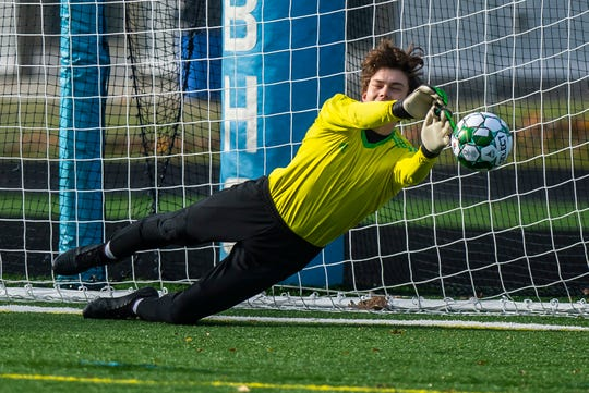 Stowe keeper Isaiah Schaefer-Geiger makes the save on a Middlebury penalty shot in the first half of the the Div. 2 Vermont boys soccer championship at South Burlington High School on Saturday, Nov. 2, 2019, Stowe won, 2-0.