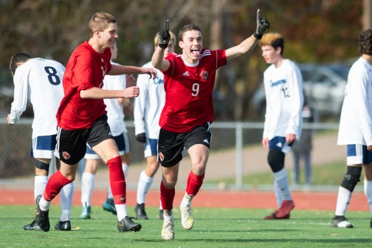 CVU's Jonah Roberts (9) celebrates after scoring a goal during the DI boys soccer championship game between the Mount Mansfield Cougars and the Champlain Valley Union Redhawks at Buck Hard Field on Saturday morning November 2, 2019 in Burlington, Vermont.