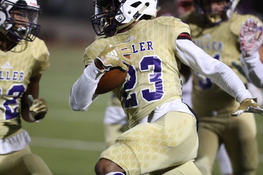 Miller takes on Ray in a high school football game on Friday, Nov. 1, 2019 at Buc Stadium in Corpus Christi, Texas.