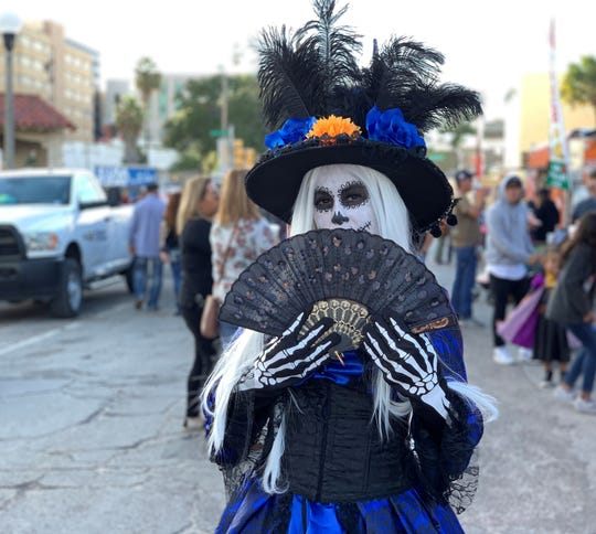 Melissa Martinez poses as a Catrina at the 12th annual Dia de los Muertos Street Festival in downtown Corpus Christi on Saturday, Nov. 2, 2019.