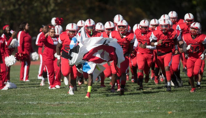 The Penns Grove High School football team enters the field prior to the game between Penns Grove and Salem and played at Penns Grove High School on Saturday, November 2, 2019.