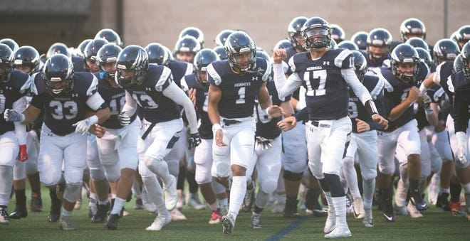 The St. Augustine Prep High School football team enters the field prior to the football game between Williamstown and St. Augustine Prep played at St. Augustine Prep High School on Friday, November 1, 2019.  St. Augustine Prep defeated Williamstown, 21-7.